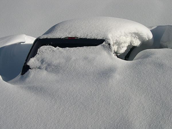 Snow buried truck at Alta Ski Resort