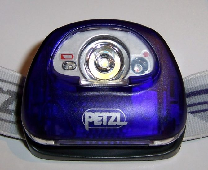 L to R: battery indicator, white LED in spot mode, red light bulb