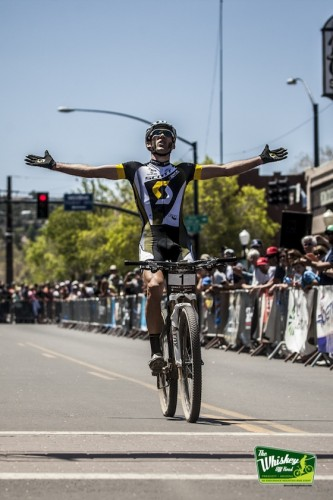 Kabush celebrates across the finish line on Whiskey Row. Photo Courtesy Whiskey Off Road / DevonBaletphoto.com