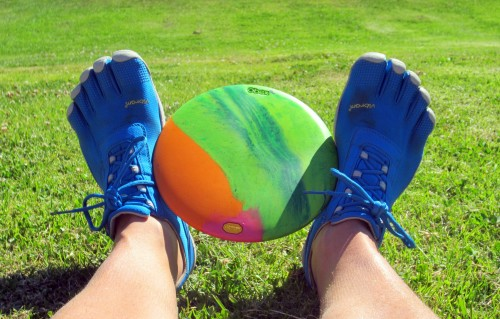 Tarzan a player wearing Toe Shoes to play disc golf. See picture