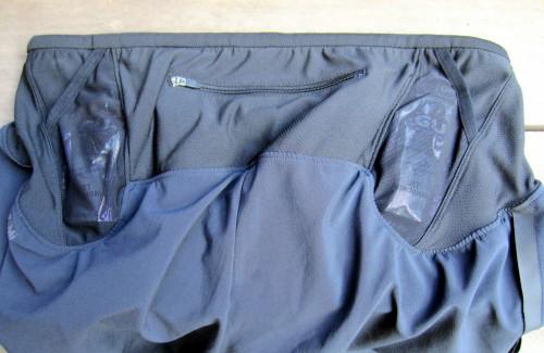 Two integrated gel pockets beside larger zipper pocket