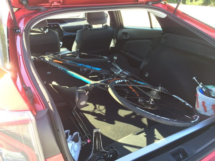 With the seats down, the Prius Four can swallow a road bike with ease.