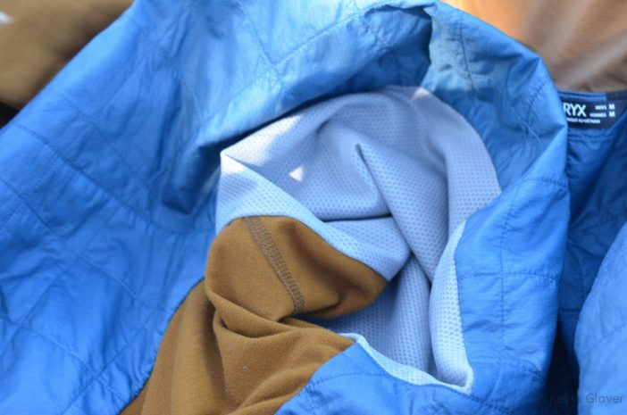 Note the three fabrics - brown is polyester/elastane on the side panels, grey is a breathable wicking mesh and blue is the Coreloft grid.
