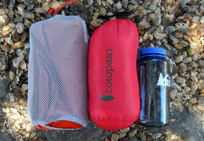 Ledft to right: Big Agnes Q-Core sleep pad, Cotopaxi Kusa blanket in stuff sack, 32-oz Nalgene bottle