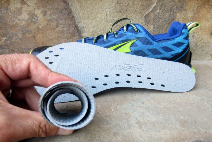 Thin, flexible, removable rock plate