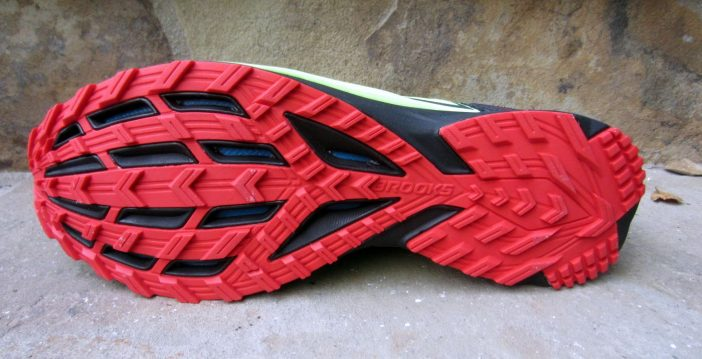 Outsole lugging; forefoot plate visible through gaps